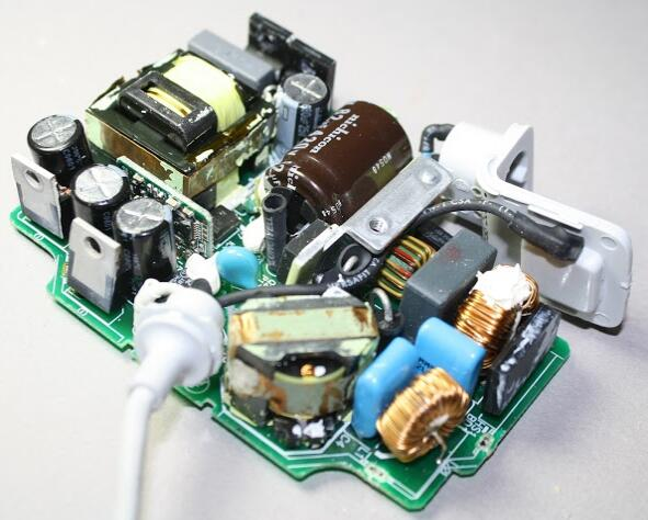 Internal parts of the MacBook power adapter